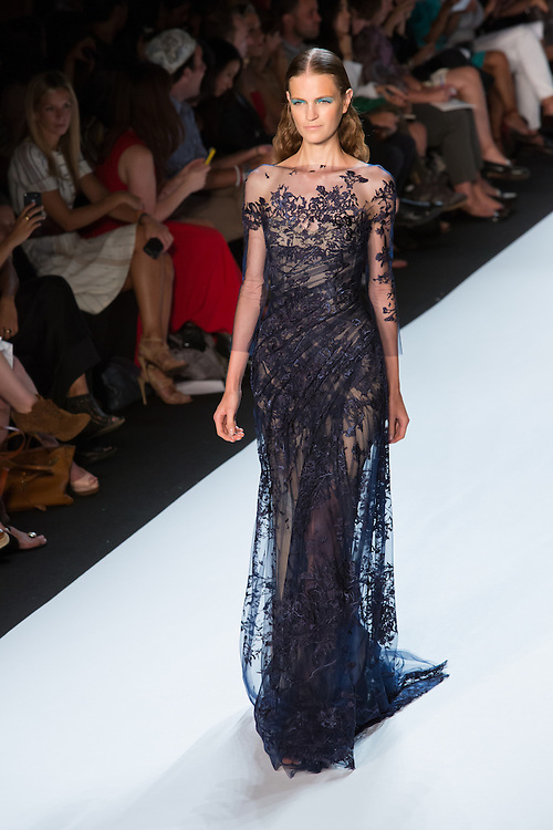 Navy gown with embroidery and tulle. By Monique Lhuillier at Spring 2013 Fall Fashion Week in New York.