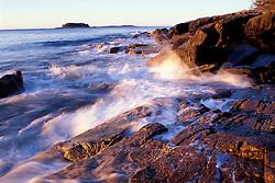 Schoodic Harbor, Acadia N.P., ME. Rocky Coast. Schoodic Peninsula. Sunlight hits the waves.