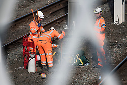 © Licensed to London News Pictures. 26/08/2017. London, UK. Workmen carry out maintenance and upgrade work on the tacks at Euston station in London, which is closed over the bank holiday weekend for upgrade work. Passengers travelling over the bank holiday have been warned not to use trains as major engineering work affecting several lines is predicted to cause travel chaos. Photo credit: Ben Cawthra/LNP