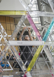 February 6, 2018 - Christchurch, Canterbury, New Zealand - Artist PETER TREVELYAN of Christchurch attempts, with the community's help, to put together an art project made with 4,000 rulers and some nuts and bolts in the foyer of the Christchurch Art Gallery. The artwork got about 3 meters (about 10 feet) high before it collapsed. (Credit Image: © PJ Heller via ZUMA Wire)