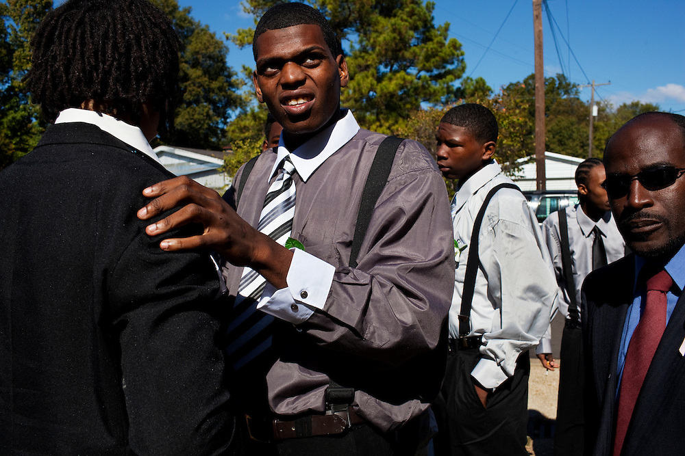 "Friends and family of Demetrius ""Butta"" Anderson, 18, gather outside McKinney Chapel in the  Baptist Town neighborhood of Greenwood, Mississippi on Friday, November 5, 2010 for the young man's funeral. Butta was shot and killed on October 27, 2010."