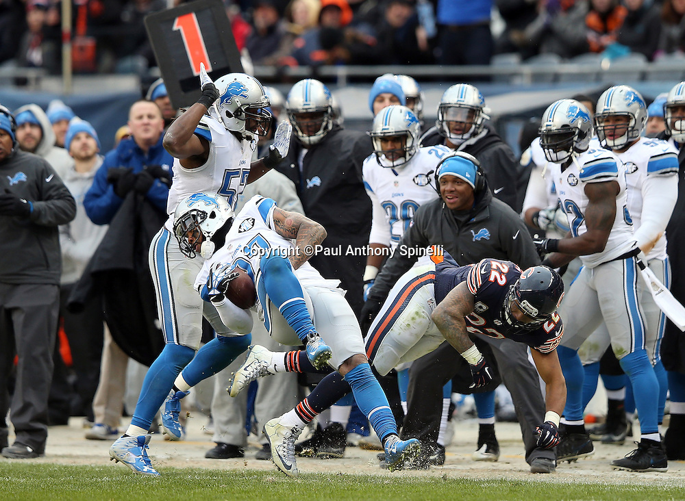 Detroit Lions free safety Glover Quin (27) intercepts a late fourth quarter pass intended for Chicago Bears running back Matt Forte (22) that clinches the win during the NFL week 17 regular season football game against the Chicago Bears on Sunday, Jan. 3, 2016 in Chicago. The Lions won the game 24-20. (©Paul Anthony Spinelli)