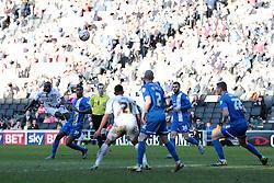 Milton Keynes Dons' Sanmi Odelusi (27) tries a shot  - Photo mandatory by-line: Nigel Pitts-Drake/JMP - Tel: Mobile: 07966 386802 15/03/2014 - SPORT - FOOTBALL -  Stadium MK - Milton Keynes - Milton Keynes Dons v Peterborough United - Sky Bet League One