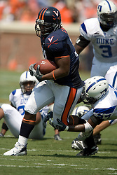 Virginia fullback Rashawn Jackson (31) breaks a tackle from Duke safety Chris Davis (27).  The Virginia Cavaliers defeated the Duke Blue Devils 23-14 at Scott Stadium in Charlottesville, VA on September 8, 2007  With the loss, Duke extended their longest-in-the-nation losing streak to 22 games.