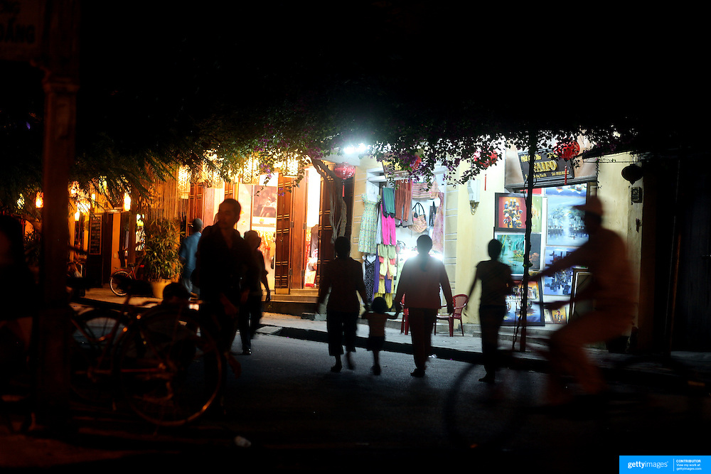 An evening street scene in Hoi An, Vietnam. Hoi An is an ancient town and an exceptionally well-preserved example of a South-East Asian trading port dating from the 15th century. Hoi An is now a major tourist attraction because of its history. Hoi An, Vietnam. 5th March 2012. Photo Tim Clayton