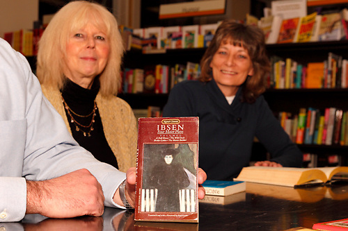 (from left) Steve Turek of Oakwood holds up a copy of IBSEN, one of the classics recently discussed by the Classics Book Club as Bonnie Doczy of Springboro and Donna Beddies of Dayton look on during a meeting at Books & Company in The Greene, Monday, March 5, 2012.