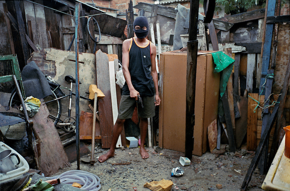 Marcello, 18 year old drug trafficker. The average life expectancy of drug dealers in favelas does not exceed 23 years. The Red Command and the Third Command are the two major cartels operating the drug traffic in Rio de Janeiro. Each cartel has almost total control of its own favelas. The more established the drug traffic within in a favela, the more stability and the less violence there is. Vigario Geral is one of numerous favelas where the leadership is not established. Which is why frequent attacks between rival gangs invariably end up as wild-west style gunfights in the middle of the street. Rio de Janerio, Brazil. 2001