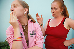 Carer or mother with upset girl.