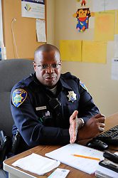 Officer Jeffrey Lofton explains some of his duties from his desk at the Hebbron Community Center in Salinas. The Community Alliance for Safety and Peace is an ambitious program that aims to steer youth away from gang violence and toward solutions offered by more than 30 local organizations offering alternatives.