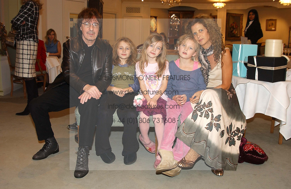 Musician BILL WYMAN andf his wife SUZANNE with their children, left to right, KATIE, JESSE & MATILDA at a children's party in aid of the charity Over The Wall held at Fortnum & Mason, Piccadilly, London before a gala premiere of the new musical Mary Poppins at The Prince of Wales Theatre, Old Compton Street, London W1<br /><br />NON EXCLUSIVE - WORLD RIGHTS