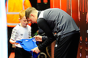 Everton defender John Stones signing a shirt for a mascot before the The FA Cup match between Bournemouth and Everton at the Goldsands Stadium, Bournemouth, England on 20 February 2016. Photo by Graham Hunt.