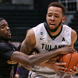 Feb 24, 2016; New Orleans, LA, USA; Tulane Green Wave guard Louis Dabney (0) has the ball stripped by East Carolina Pirates guard Prince Williams (4) during the second half of a game at the Devlin Fieldhouse. East Carolina defeated Tulane 79-73. Mandatory Credit: Derick E. Hingle-USA TODAY Sports
