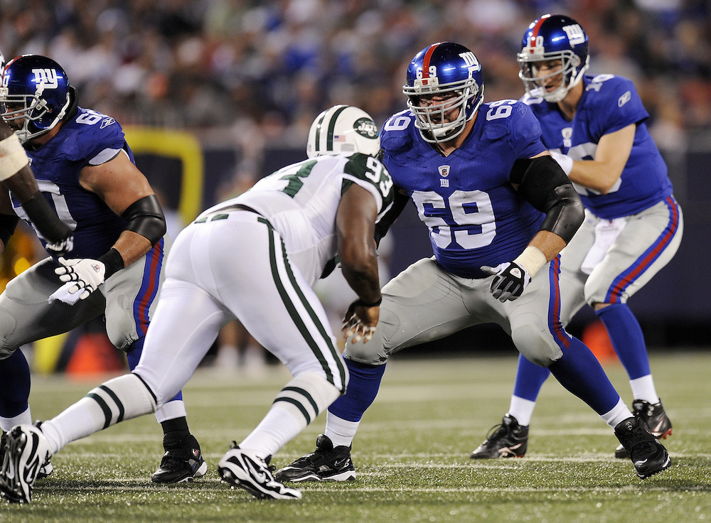 EAST RUTHERFORD, NJ - AUGUST 29: Rich Seubert #69 of the New York Giants blocks against the New York Jets in a preseason game at Giants Stadium on August 29, 2009 in East Rutherford, New Jersey. The New York Jets beat the New York Giants 27-25. (Photo by Rob Tringali) *** Local Caption *** Rich Seubert