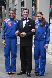"© Licensed to London News Pictures. 30/06/2012. London, England. L-R: Jenna Randall, Robin Cousins and Olivia Federici. Olympic Gold Medallist Robin Cousins poses with Jenna Randall and Olivia Federici from Team GB's Synchronised Swimming Team, whom he mentors. Robin Cousins will take up the role of ""Billy Flynn"" in the musical Chicaco at the Garrick Theatre from 17 July 2012 for a limited season. Photo credit: Bettina Strenske/LNP"