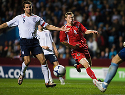 BIRMINGHAM, ENGLAND - Tuesday, October 14, 2008: Wales' Sam Vokes and England's Steven Taylor during the UEFA European Under-21 Championship Play-Off 2nd Leg match at Villa Park. (Photo by Chris Ratcliffe/Propaganda)
