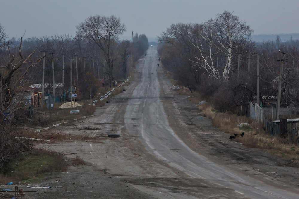 PERVOMAISKE, UKRAINE - NOVEMBER 18, 2014: The main street in the village of Pervomaiske, Ukraine. The area, close to Donetsk airport, has seen heavy fighting in recent months. CREDIT: Brendan Hoffman for The New York Times