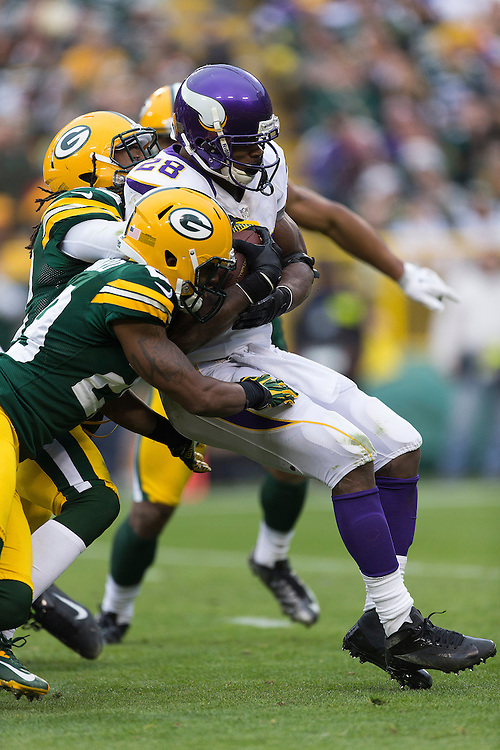 GREEN BAY, WI - DECEMBER 2:  Adrian Peterson #28 of the Minnesota Vikings is tackled by Morgan Burnett #42 of the Green Bay Packers at Lambeau Field on December 2, 2012 in Green Bay, Wisconsin.  The Packers defeated the Vikings 23-14.  (Photo by Wesley Hitt/Getty Images) *** Local Caption *** Adrian Peterson; Morgan Burnett