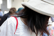 female person with shoulder bag and hat