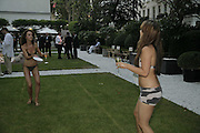 Amy Manson and Virginia Godwin ( check)playing ping pong.  Ruinart party at The Hempel, Hempel Gardnes.  Craven Hill Gardens. 18 July 2006. <br />