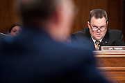 Montana Senator Jon Tester (D) listens to testimony during an armed services budget hearing on Capitol Hill.