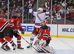 Nov 5, 2010; Newark, NJ, USA;  New York Rangers left wing Brandon Dubinsky (17) celebrates a goal by New York Rangers center Brian Boyle (22) during the second period of their game against the New Jersey Devils at the Prudential Center.