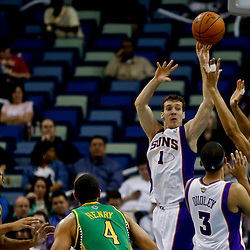 Feb 6, 2013; New Orleans, LA, USA; Phoenix Suns point guard Goran Dragic (1) is defended by New Orleans Hornets power forward Anthony Davis (23) during the second quarter of a game at the New Orleans Arena. Mandatory Credit: Derick E. Hingle-USA TODAY Sports