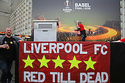 Liverpool fan kisses the trophy on the poster before the Europa League Final match between Liverpool and Sevilla at St Jakob-Park, Basel, Switzerland on 18 May 2016. Photo by Phil Duncan.