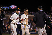 San Francisco Giants second baseman Joe Panik (12) celebrates after hitting walk off double to bring in shortstop Brandon Crawford (35) in the 13th inning against the Chicago Cubs during Game 3 of the NLDS at AT&T Park in San Francisco, Calif., on October 10, 2016. The San Francisco Giants beat the Chicago Cubs 6-5. (Stan Olszewski/Special to S.F. Examiner)