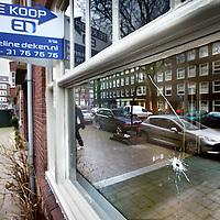 Nederland, Amsterdam , 2 maart 2012..kogelgaten in een koopwoning op het R. Claessenplein in Amsterdam West..Foto:Jean-Pierre Jans