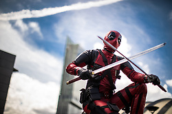 © Licensed to London News Pictures . 30/07/2017 . Manchester , UK . Deadpool (Matt Holland , 19 , from Blackpool) outside the venue . Cosplayers, families and guests at Comic Con at the Manchester Central Convention Centre . Photo credit : Joel Goodman/LNP