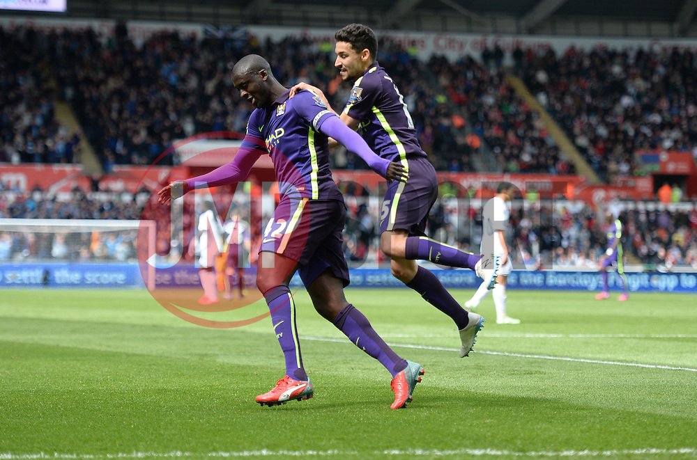 Manchester City's Yaya Toure celebrates with Manchester City's Jesus Navas - Photo mandatory by-line: Alex James/JMP - Mobile: 07966 386802 - 17/05/2015 - SPORT - Football - Swansea - The Liberty stadium - Swansea City v Manchester City - Barclays premier league