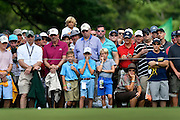 Jul 29, 2016; Springfield, NJ, USA; Spectators watch Bubba Watson's putt on the 15th hole during the second round of the 2016 PGA Championship golf tournament at Baltusrol GC - Lower Course. Mandatory Credit: Eric Sucar-USA TODAY Sports