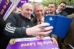 © Licensed to London News Pictures . 25/05/2016 . Bolton , UK . NIGEL FARAGE signs placards and poses for selfies . The UKIP referendum bus tour , campaigning for a UK Brexit , lead by Nigel Farage , in Victoria Square , Bolton . Photo credit : Joel Goodman/LNP