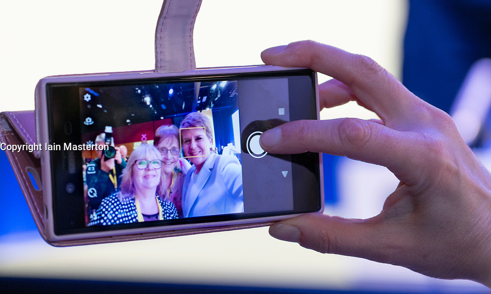 Edinburgh, Scotland, UK. 27 April, 2019. SNP ( Scottish National Party) Spring Conference takes place at the EICC ( Edinburgh International Conference Centre) in Edinburgh. Pictured; First Minister Nicola Sturgeon taking selfie photographs with delegates on Day one of the conference