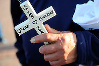 "Gregorio Rios, from Seaside, holds a cross with his nephew's name on it at a mid-November dedication ceremony at Closter Park in Salinas. The group ""A Time for Grieving and Healing"" unveiled a memorial to victims of violence in Monterey County."