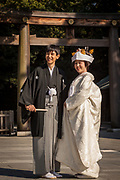 Couple get married in traditional Shinto ceremony, Tokyo, Japan.