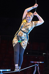 © Licensed to London News Pictures. 22/04/2015. Guildford, UK. Kelly-Marie Blundellis guided through the process by comedy artist Vladimir Georgieski and high wire walker Olga Roxhkovskaya. Liberal Democrat Kelly-Marie Blundell walks the high wire at Moscow State Circus in Guildford. Photo credit : Stephen Simpson/LNP