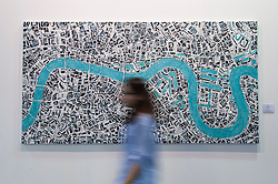 "© Licensed to London News Pictures. 19/05/2016. London, UK. A visitor walks in front of Barbara Macfarlane's ""Sulphur Thames"".  Art16 opens at Olympia, in west London.  Now in its fourth edition, the fair brings together over 100 galleries from more than 30 countries showcasing a diverse cross-section of work by contemporary artists from around the world for buyers and art enthusiasts to visit. Photo credit : Stephen Chung/LNP"