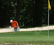 Stephen Mckalko of Troy plays from the greenside bunker of the par 4 11th hole of the Heather course at Boyne Highlands during second round match play at the Michigan Amateur Golf Championship.