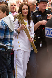 © Licensed to London News Pictures. 19/05/2012. Truro, UK. Olympic torchbearer number 64 prepares to carry the Olympic flame through Truro, Cornwall as part of the 70 day relay across the UK. Photo credit : Ashley Hugo/LNP