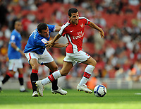 Fotball<br /> England<br /> Foto: Fotosports/Digitalsport<br /> NORWAY ONLY<br /> <br /> Cesc Fabregas<br /> Arsenal 2009/10<br /> Lee McCulloch Rangers<br /> Arsenal V Rangers (3-0) 02/08/09 at the Emirates Stadium<br /> The Emirates Cup 2009