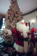 Santa Claus stands in front of the 1998 White House Christmas tree decorations December 7, 1998 in Washington, DC. This year's theme was based around A Winter Wonderland.
