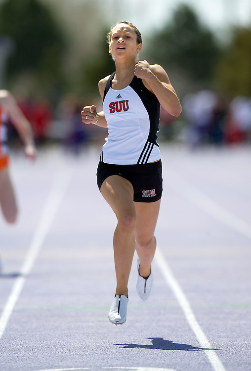 Tracee Jones of SUU competes in the 4 X 100 meter relay and the 400 meter sprint coming in 1st in the 400 meter with a time of 55.61 seconds during a track meet at Weber State University in Ogden, Utah Saturday April 8, 2006. August Mille