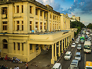 21 OCTOBER 2015 - YANGON, MYANMAR:   Traffic on Strand Road in Yangon passes the Myanmar Airlines building, a colonial era building on the Yangon waterfront. PHOTO BY JACK KURTZ