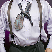 An overweight businessman with a bad knot in his necktie. Metaphor for incompetence, inability, or beomg unprepared.