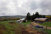 A view of the Apple Pond Farm with its wind turbine in the left side and the solar panels in the right. Sonja Hedlund and Dick Riseling run an organic farm, Apple Pond Farm, two hours away from New York city and offer workshops for children so they can learn how to farm. The farm runs 75% of their electricity on a wind turbine and solar panels.