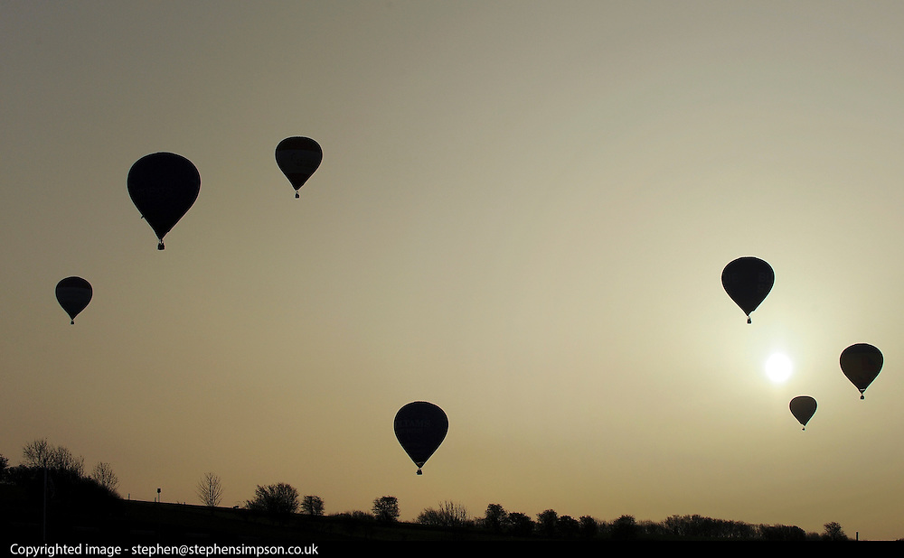 London News pictures. 07/04/2011. CANTERBURY: Balloons head off towards the channel. Approximately 50 hot air balloons from across the UK and Europe take advantage of the weather window and take off from Lydden Hill Race Circuit, Wootton, Kent, to fly across the English Channel marking the largest ever group of balloons to attempt the crossing. The participants  have been waiting since October for the event to happen. Picture credit should read Stephen Simpson/LNP