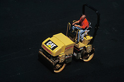 Industrial asphalt road construction equipment.