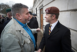 © Licensed to London News Pictures. 03/02/2018. London, UK. UKIP Leader Henry Bolton wears a beret of The Royal Hussars, his former British Army regiment, as he meets a veteran from Northern Ireland during the Veterans for Justice March in central London .Photo credit: Peter Macdiarmid/LNP