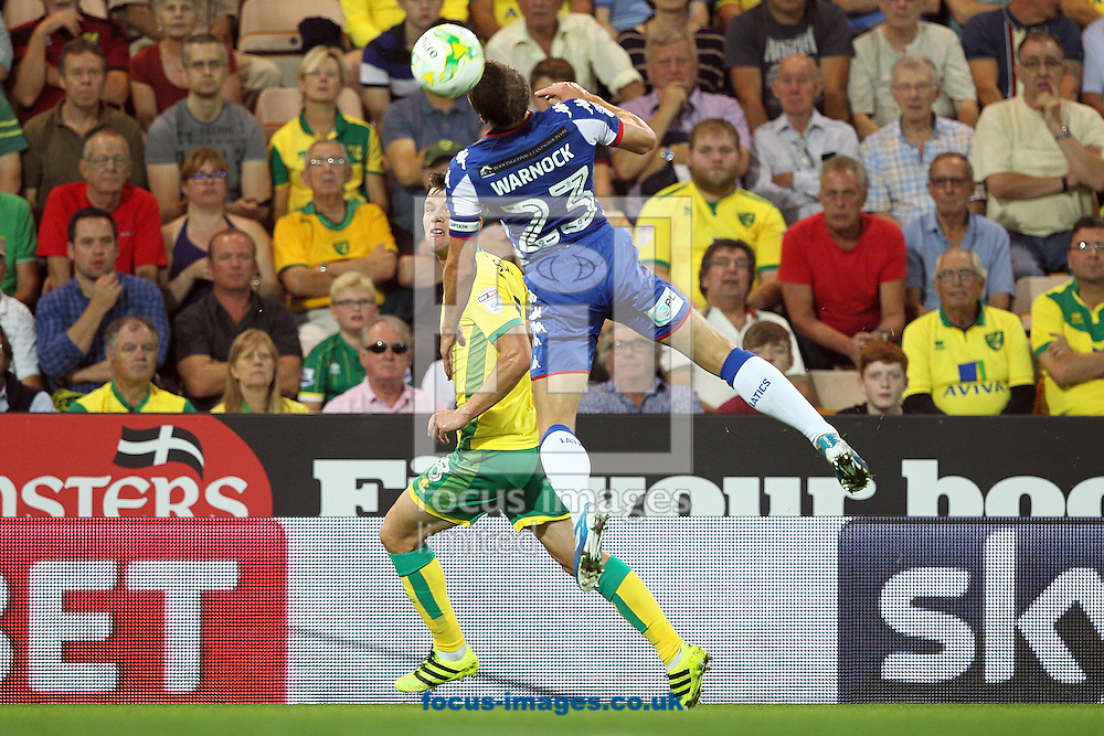 Jonny Howson of Norwich and Stephen Warnock of Wigan Athletic in action during the Sky Bet Championship match at Carrow Road, Norwich<br /> Picture by Paul Chesterton/Focus Images Ltd +44 7904 640267<br /> 13/09/2016